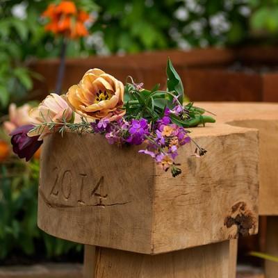 Garden seat with tulips, Harrogate Best in Show garden