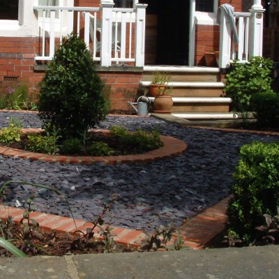 Small front garden with slate clippings and brick edge, central Bay tree, West Park, Leeds