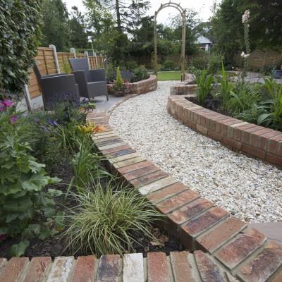 Cottage garden planting in raised beds, Cookridge back garden