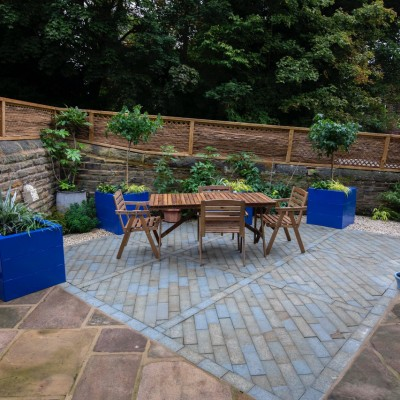 Headingley back yard, planters inspired by Jardin Marjorelle. Yorkshire flagstones were pre-existing and re-laid with new sawn sandstone setts