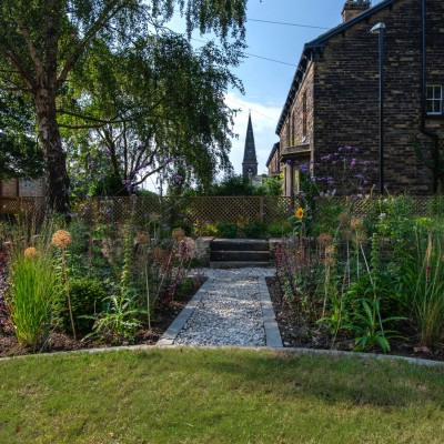 New Perennial planting style, with 'borrowed landscape' of Church, Headingley