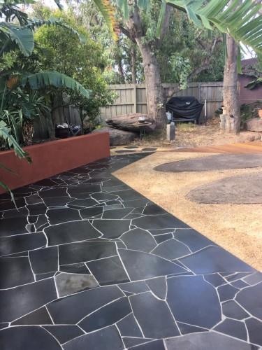 Australian back yard with blue stone crazy paving