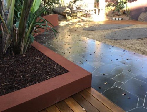 Constructed Australian back yard with blue stone crazy paving
